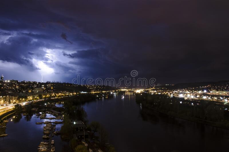 River and lightning on the sky during summer thunderstorm in Prague. Czech republic. Night view of Prague royalty free stock images
