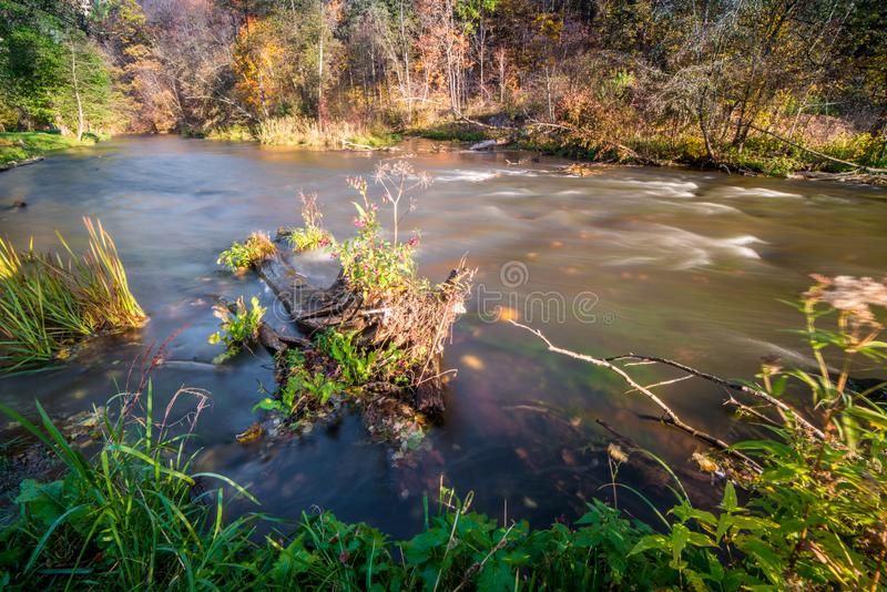 River long exposure, water in fall. Scenic nature landscape royalty free stock photography