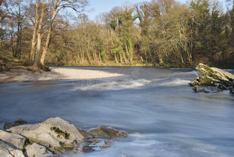 River Lune at Kirkby Lonsdale. Small rapids on the a bend of the river Lune at Kirkby Lonsdale, Cumbria, UK royalty free stock photo