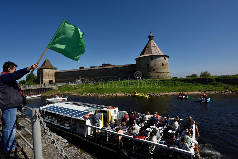 River marathon Oreshek Fortress race in St. Petersburg, Russia. Oreshek fortress, Leningrad oblast, Russia - August 15, 2015: Athletes prepare to the second stock photography