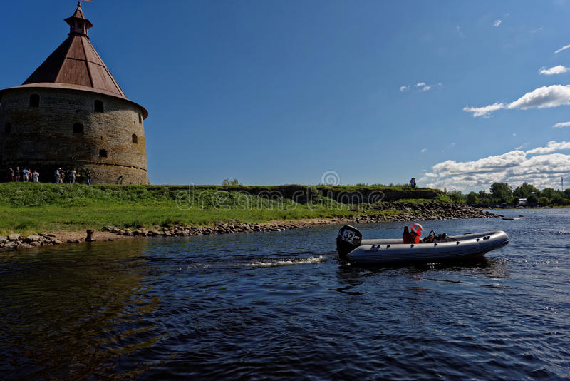 River marathon Oreshek Fortress race in St. Petersburg, Russia. Oreshek fortress, Leningrad oblast, Russia - August 15, 2015: Athletes prepare to the second stock image