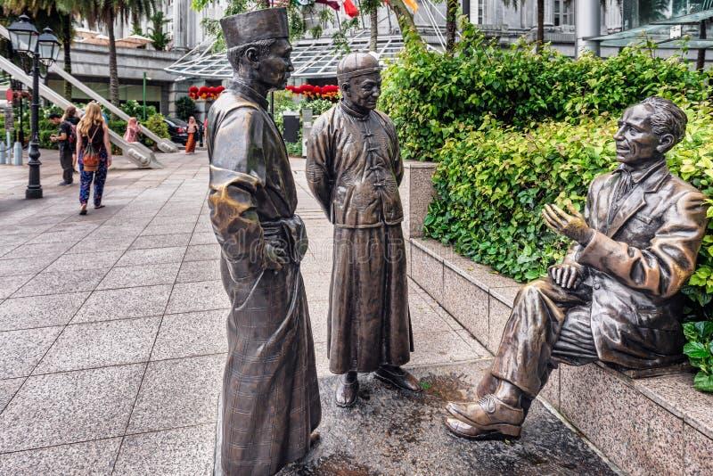 The River merchants, bronze sculpture at the riverbank in Singap. Singapore - Jan 14, 2018: The River merchants, bronze sculpture by Aw Tee Hong in the promenade stock photo