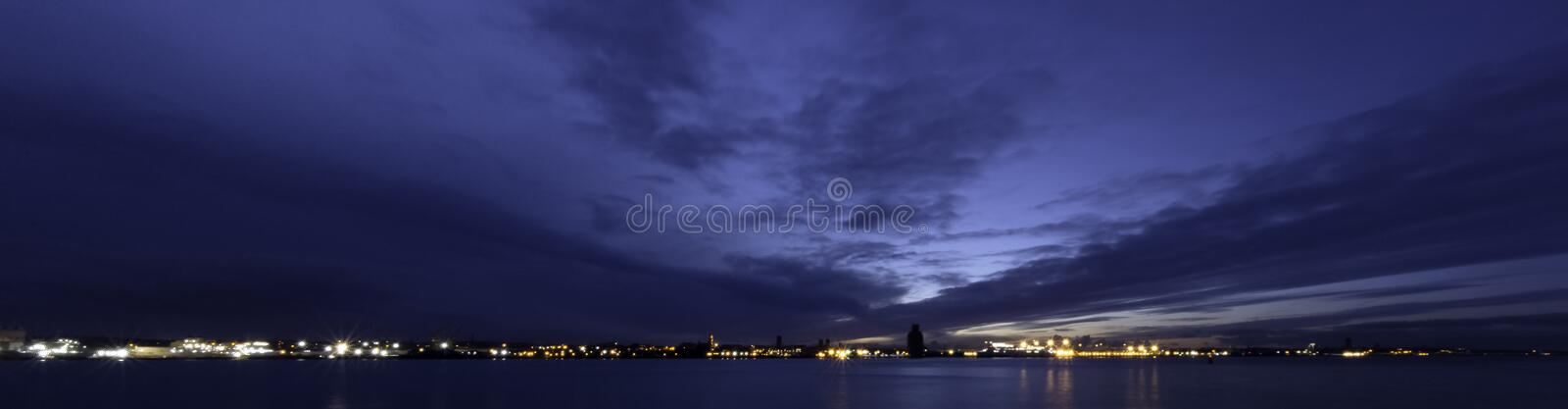 River Mersey and Birkenhead by night. Panoramic view from Keel Wharf waterfront in Liverpool, United Kingdom stock photo