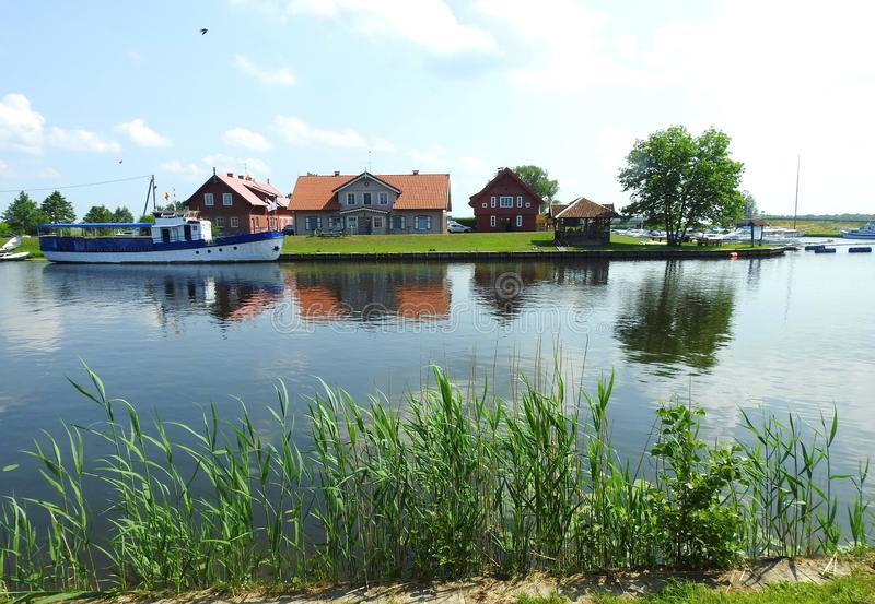 River Minija, ships and homes, Lithuania royalty free stock images