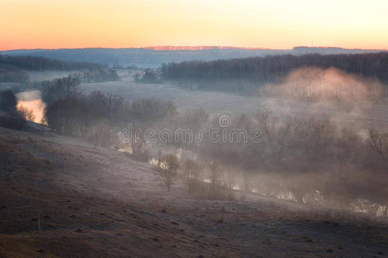 River mist lit with a rising sun. Early spring royalty free stock photo