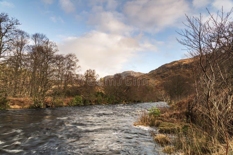 River Moidart. The fast flowing, tree lined, River Moidart running through Glen Moidart, Scotland stock image