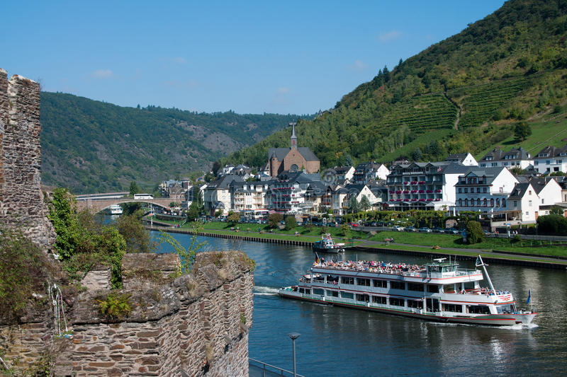 River Mosel with a tourism ship in front. Tourism ship on the river Mosel at the german city Cochem stock photography
