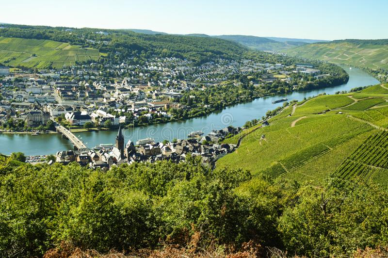 River Mosel. The river Mosel in the west part of Germany with the green vineyards and the little city Bernkastel stock photo