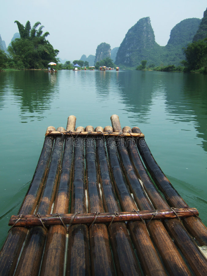 Free River, Mountain And Bamboo Raft Stock Image - 5566251