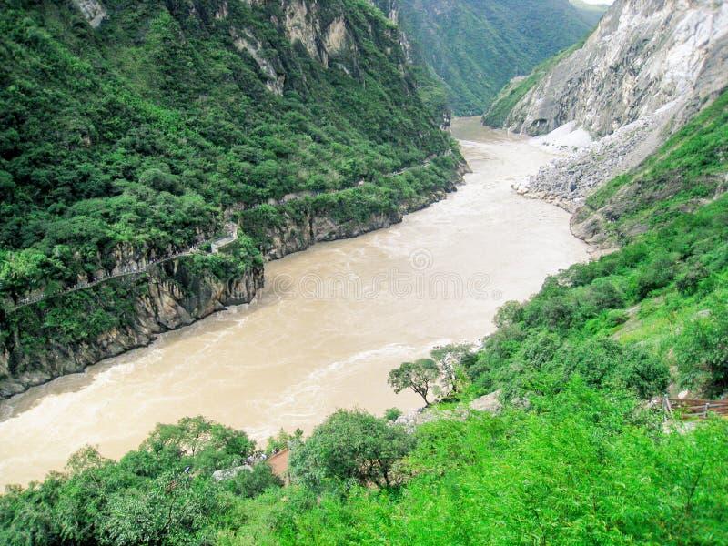 A river through the mountains stock photos
