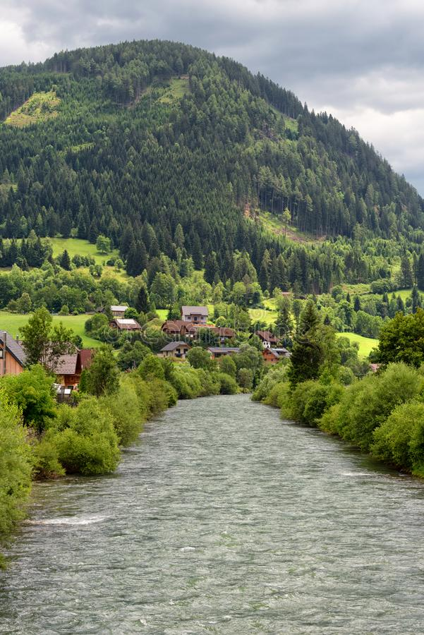 The river Mur or Mura in Austria. Banks of the Mur river in Austria. The Mur or Mura is a river in Central Europe rising in the Hohe Tauern national park of the royalty free stock images