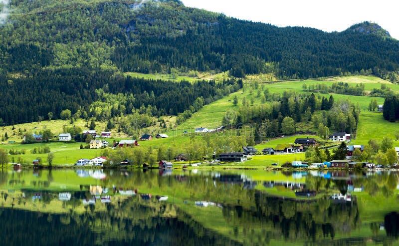 River Near Green Grass Field stock photo