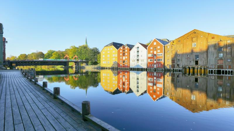 Fall in Trondheim. River Nidelva, the old bridge  den gamle Bybru and historical timver buildings and the river in the Norwegian city trondheim stock photo