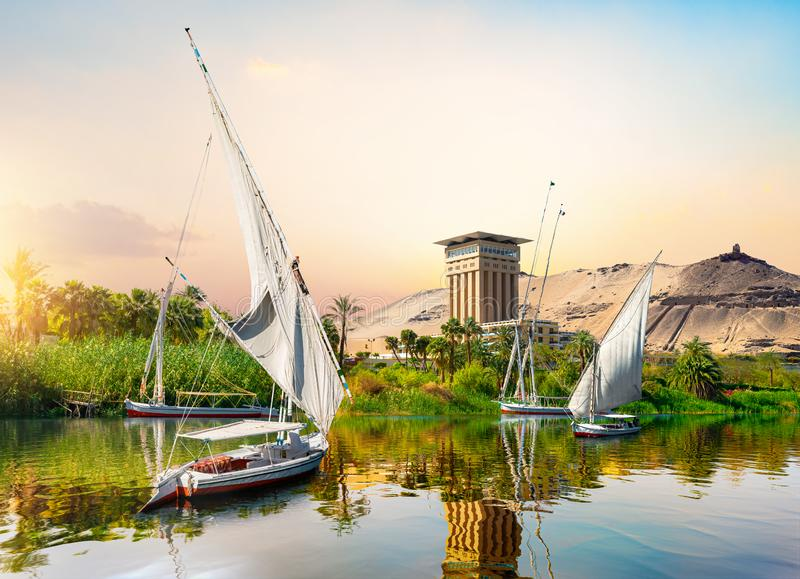 River Nile and boats. At sunset in Aswan stock photos