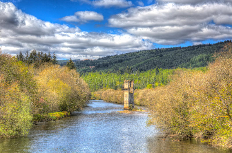 River Oich Fort Augustus Scotland UK Scottish Highlands next to Loch Ness with bridge tower in colourful H. River Oich Fort Augustus Scotland UK Scottish stock images