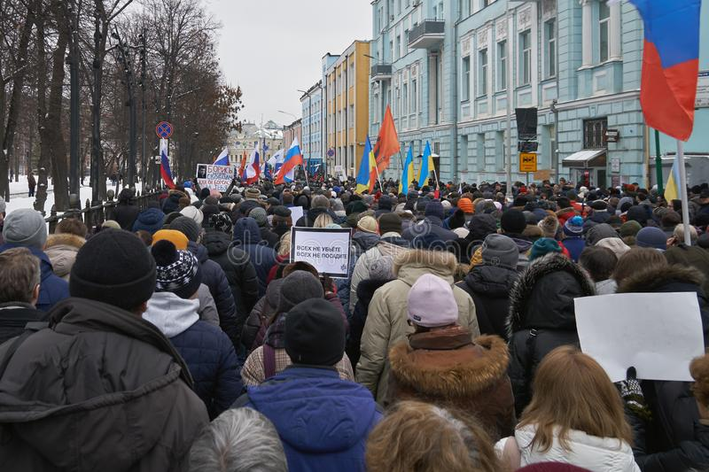 River of oppositionally to the Russian authorities people flowing with flags and banners on the streets of Moscow. Moscow, Russia - February 24, 2019. Nemtsov royalty free stock photos