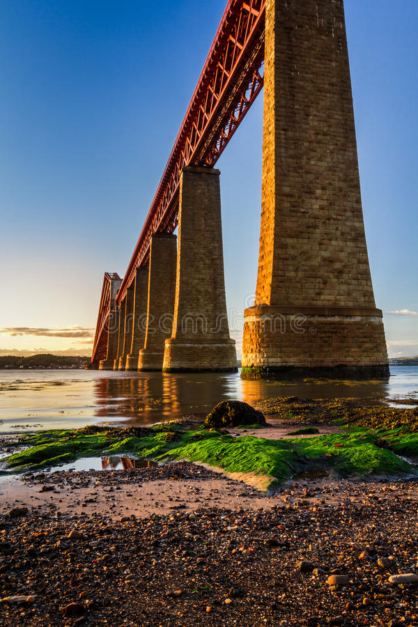 River over Forth Road Bridge at sunset royalty free stock images