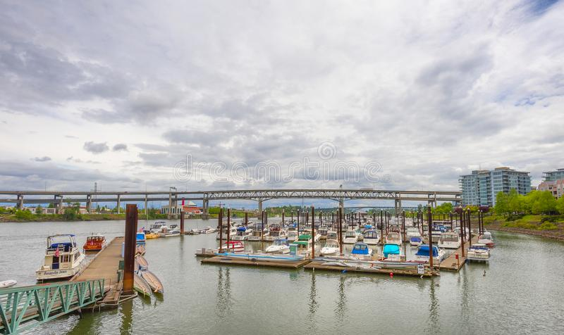 River Place Marina in Portland, Oregon. Portland, Oregon, USA - May 29, 2010: View of boats docked on the Willamette River and the Marquam Bridge that crosses it royalty free stock images
