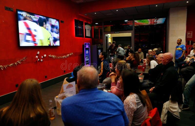 River Plate soccer team fans watching their Copa Libertadores Final game. Against Bova River in a bar in Palma de Mallorca, SPain stock photography