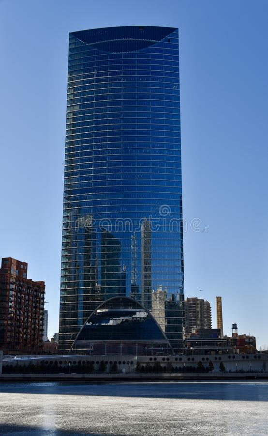 River Point Building. This is a Winter picture of the River Point Building looming over a frozen Chicago River located in Chicago, Illinois. The building royalty free stock photo