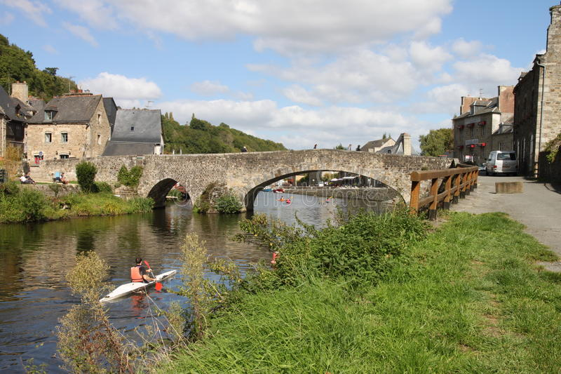 River Rance in Dinan, Britanny in France. Lower town with old bridge and canoeist stock photo