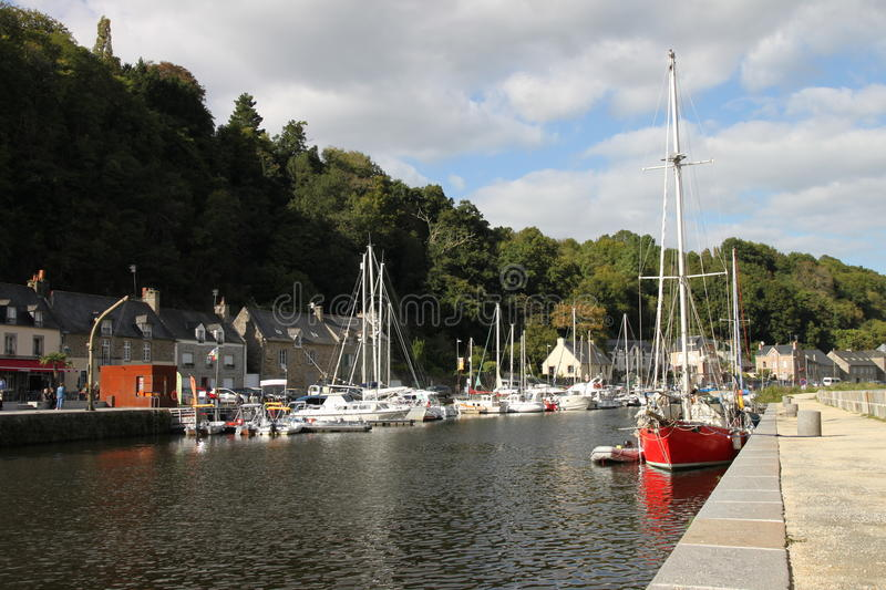 River Rance in Dinan, Normandy, France. Quayside, boats and masts. Lower Dinan in river valley stock photos