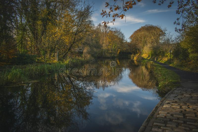River Reflection Of Autumn Landscape on a Medieval Aqueduct in Scotland royalty free stock photo