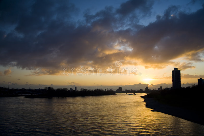 River Rhine. With sunset in Cologne, Germany stock photography