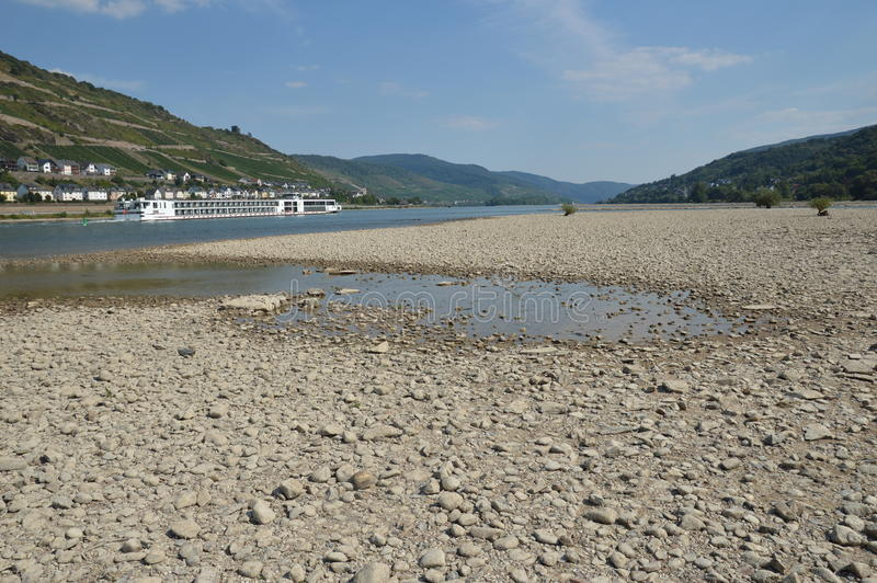 River rhine dried up. Bacharach, Germany - August 22, 2015: River rhine during heavy drought in summertime because of global warming royalty free stock images