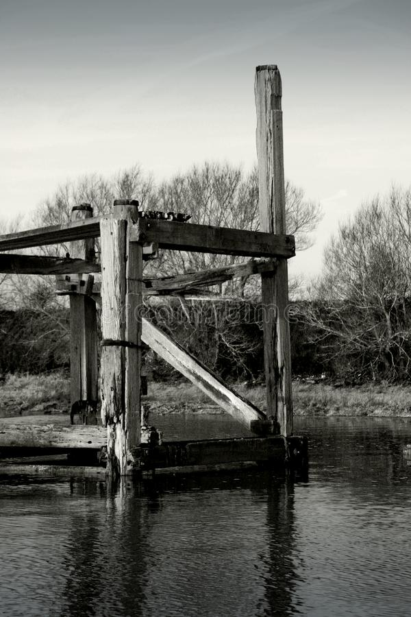 Derelict jetty in river royalty free stock images