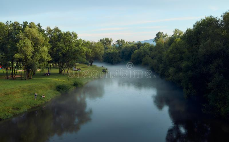 River with a rising fog after a storm. stock images