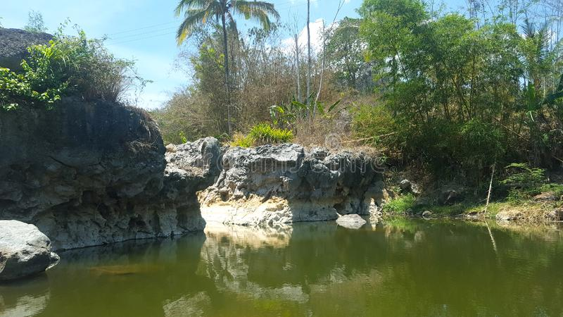 River with rock cliffs and clear water. Seemed to dry up due to long drought royalty free stock photos