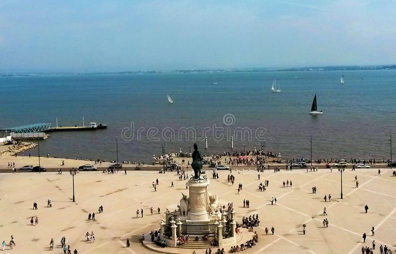 The river from Rua Augusta Arch. Praça do Comércio e Tejo River seen from Rua Augusta Arch terrace - May 2017 - Lisbon - Portugal stock image