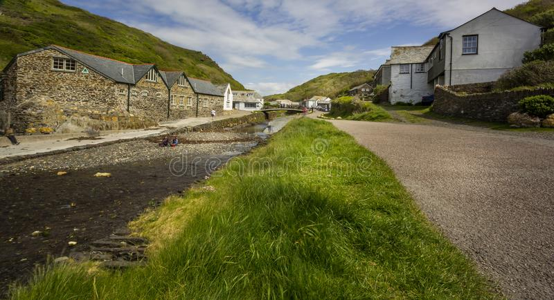 River running through middle of Boscastle harbour village in Boscastle, Cornwall, UK stock photography
