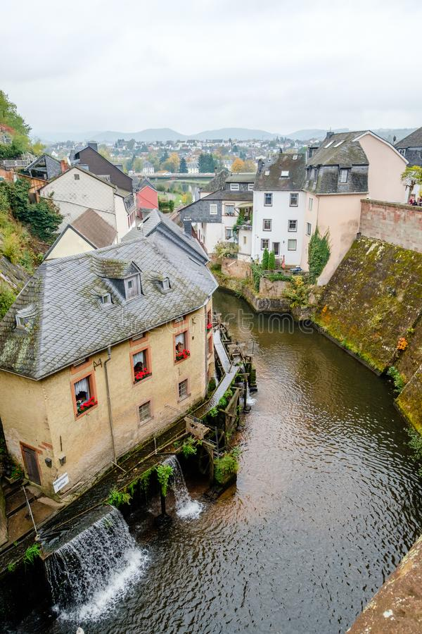River Saar with waterfall and water mills in the historic town of Saarburg, Germany stock image
