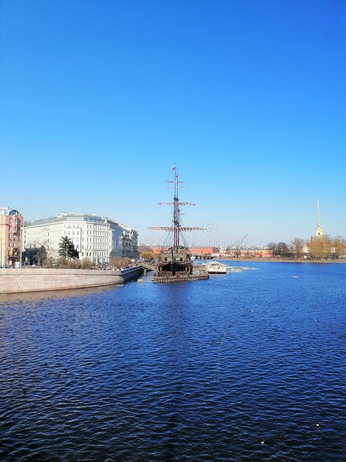River, sailboat and the spire of the fortress royalty free stock photo