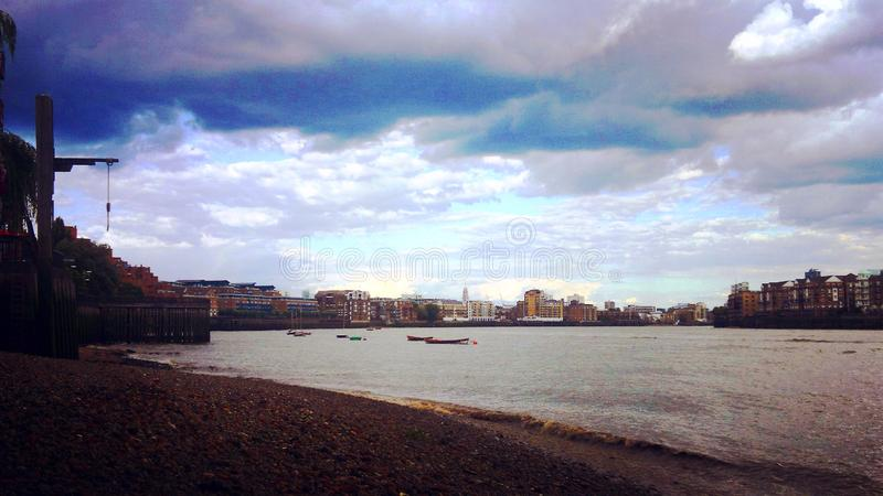 River side in London. Thames, water, cloudy, building, cityscape stock images