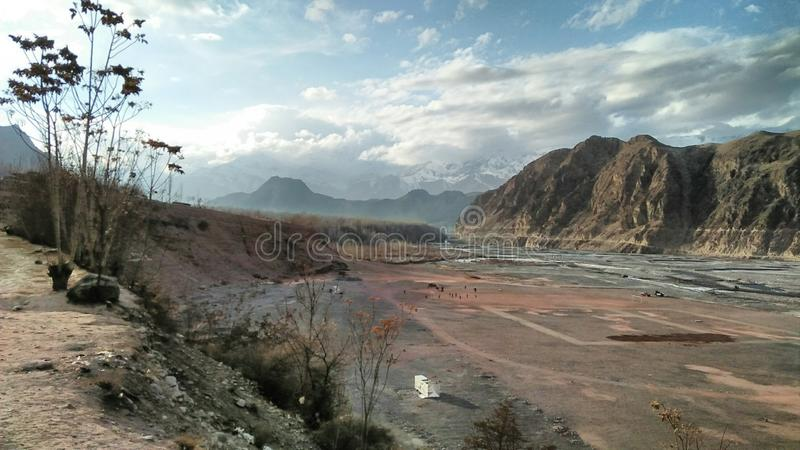 River Side with play ground. Play ground with river and mountain out side of village royalty free stock image