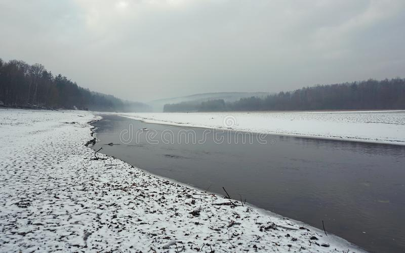 River in a silent cloudy winter country stock image