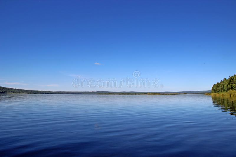 River and sky coming together in blue royalty free stock images