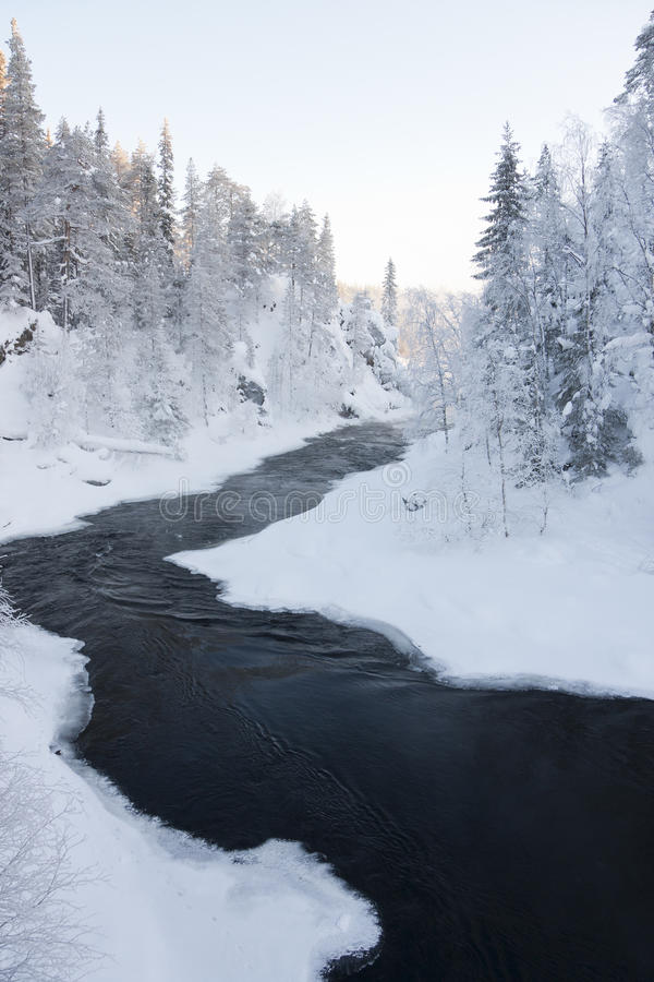 Download A River On A Snowy Landscape Stock Photo - Image: 23486396