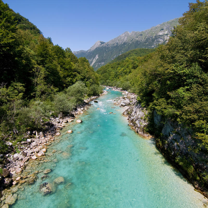 River Soca. The emerald green waters of the alpine river Soca in Slovenia stock images