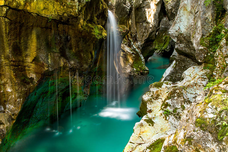 River Soca near Bovec, Slovenia. Emerald color of river Soca near Bovec, Slovenia stock photography