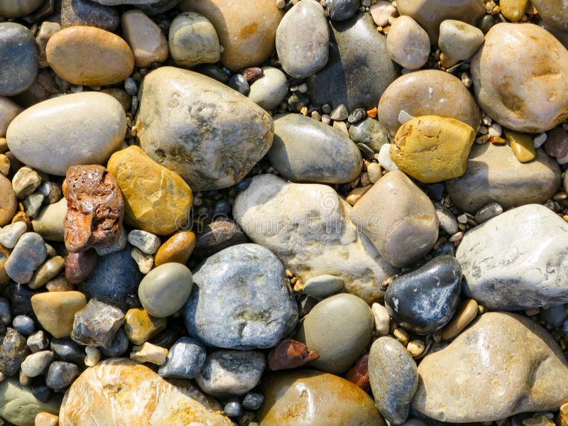 River Stone Background. A beautiful background of colorful riverstones stock photo
