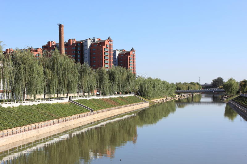 Download A River And Storied Building Stock Photography - Image: 27125702