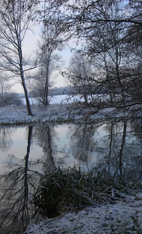 Reflections in the river stour. The River Stour runs through Sudbury and is surrounded by water meadows stock photo