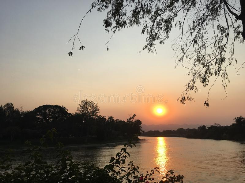 River sunset in Thailand royalty free stock photo