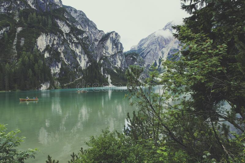 River Surrounded by Mountains during Daytime royalty free stock photos
