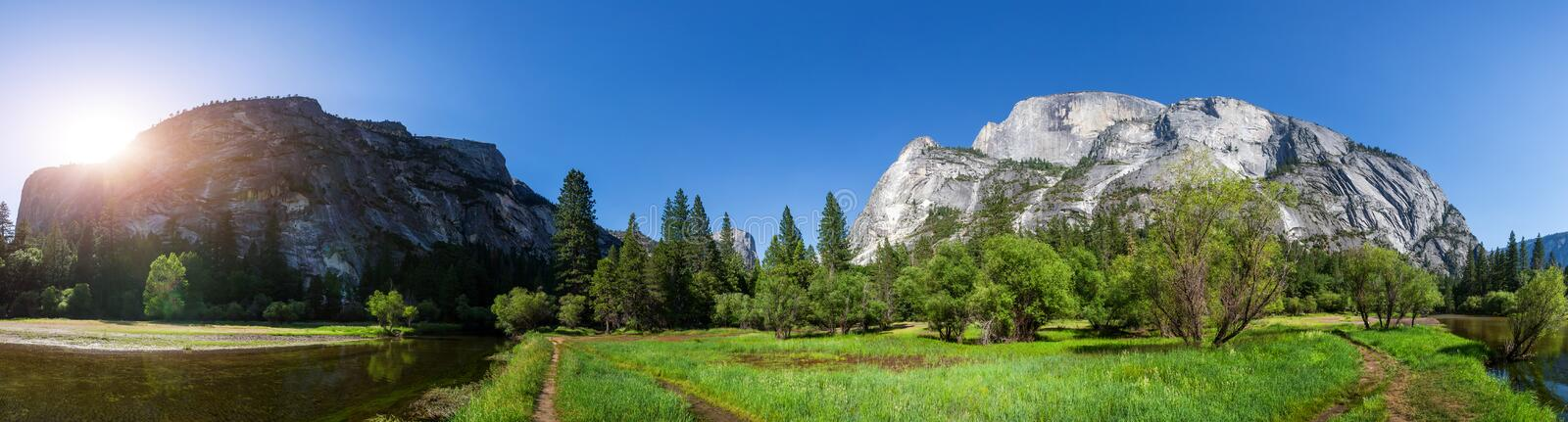 River surrounded by rocky mountains panoramic view. At Yosemite National Park, California USA stock photos