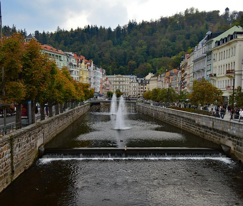 River Tepla and typical colourful terrace buildings in Karlovy Vary Czech Republic. River Tepla and typical colourful terrace building in Karlovy Vary Czech royalty free stock images